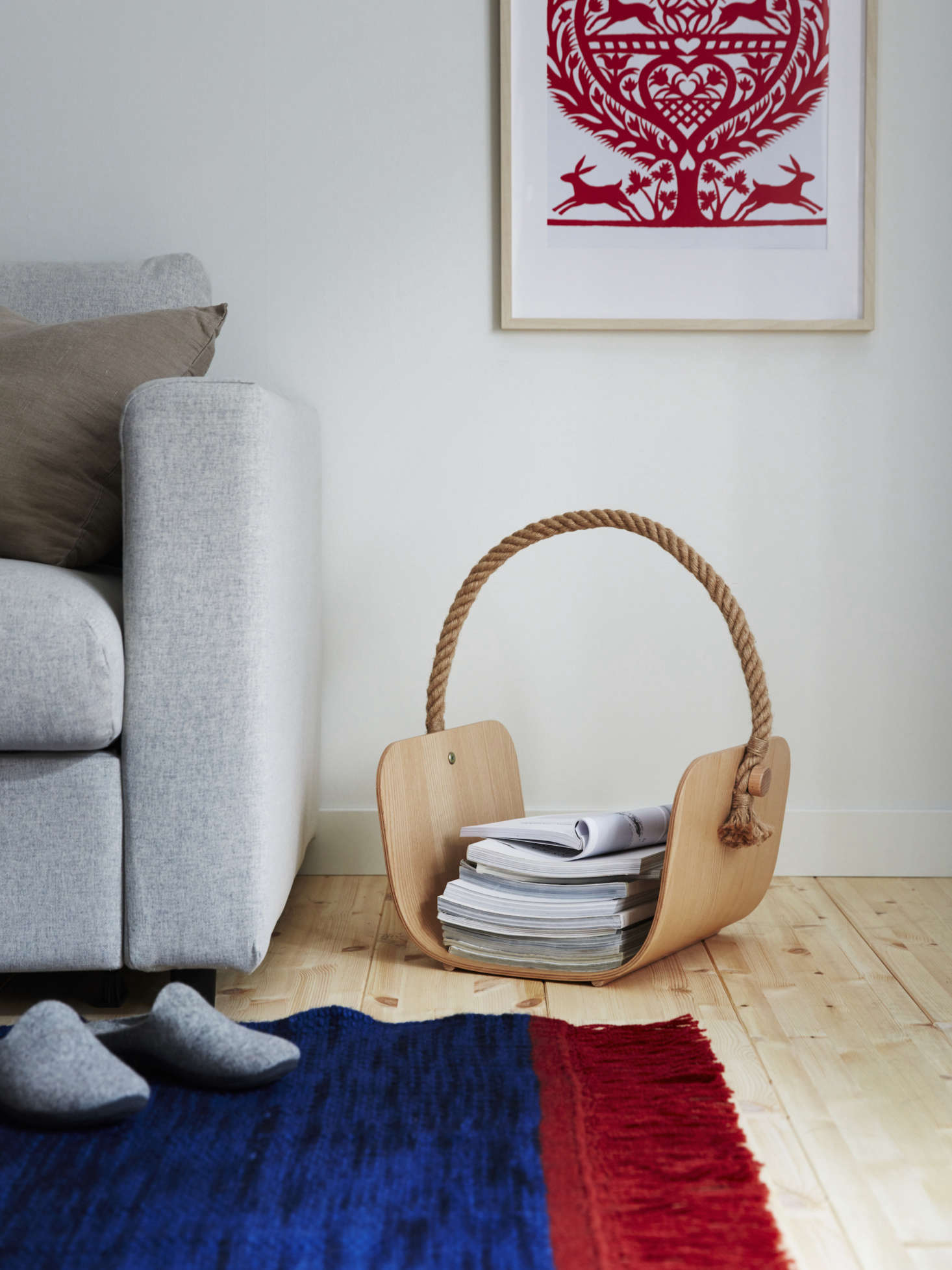 The ash veneer basket, designed bySarah Fager and Jens Fager of Sweden, boasts a hemp handle; $39.99. The flat-woven rug is 0 percent wool; $src=