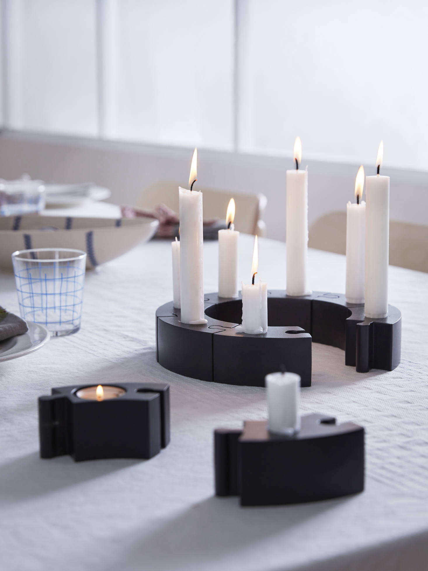 You can buy the powder-coated aluminum candle holders individually ($4.99 each) or as an 8-piece puzzle set ($39.9