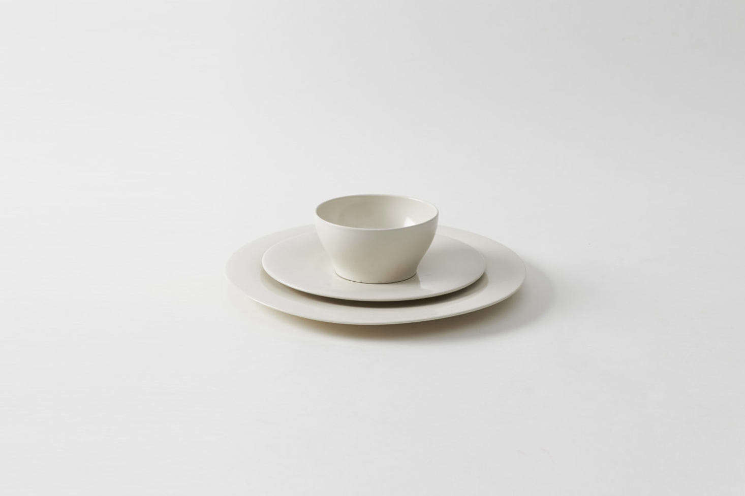 British architect John Pawson designed a set of monastic Ceramic Plates and Bowls for the refectory renovation of the Abbey of Our Lady of Nový Dvur in Bohemia. Plates in two sizes are nearly flat as if levitating above the surface of the table, and bowls are designed to be both simple and humble (small); $60-$180 at March.