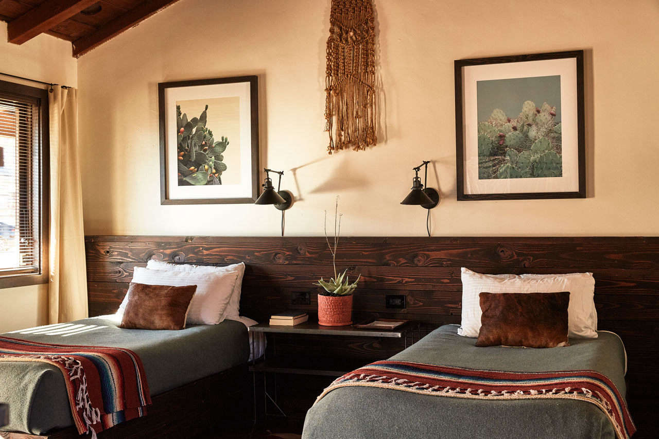Pendleton and serape blankets cover each bed.