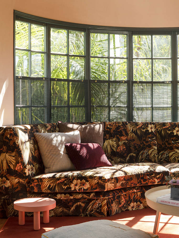 Beckoning from the living room is the showpiece of the family room, a custom sectional in a bay window upholstered in a House of Hackney velvet called Limerance (initially deemed too pricey, it was subsequently discontinued in the colorway they wanted and was being offered at a steep discount.) &#8