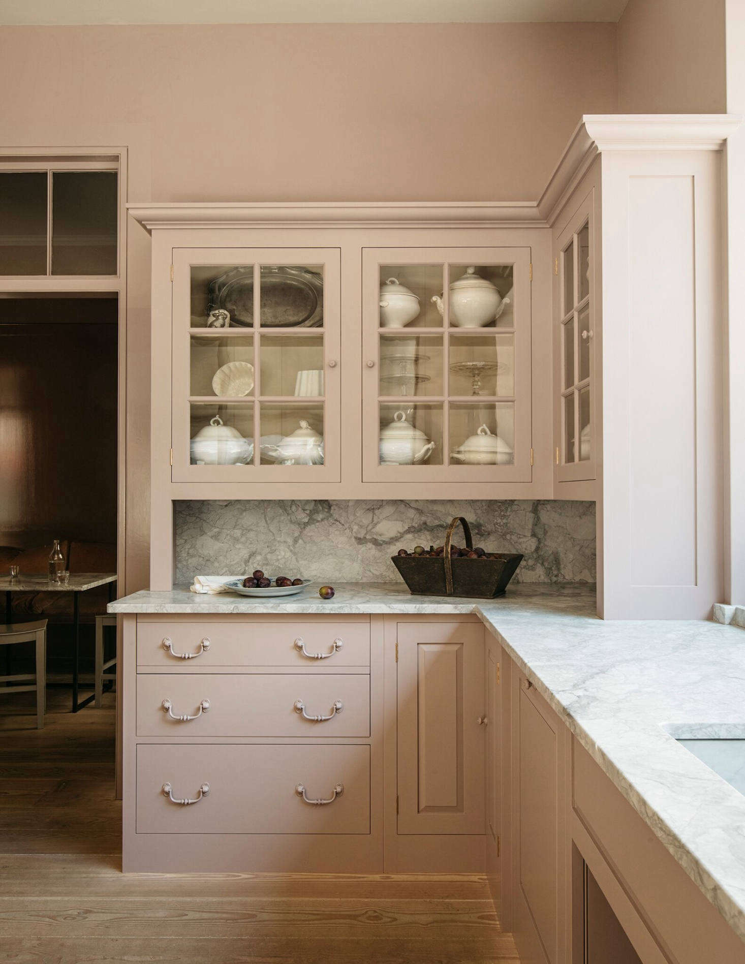The cabinets in the Marylebone showroom are painted in Mouldy Plum, &#8