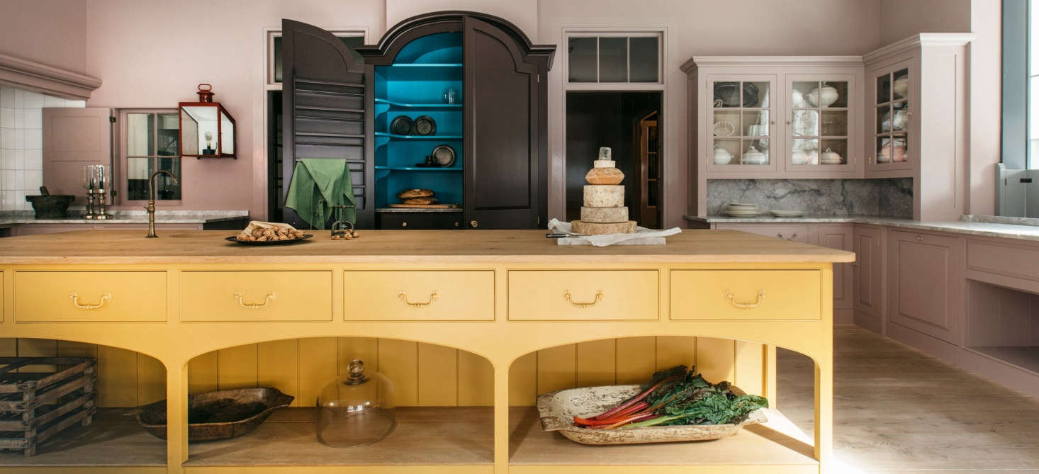The Plain English Marylebone showroom in London; the kitchen island is painted in murky gold Nicotine.