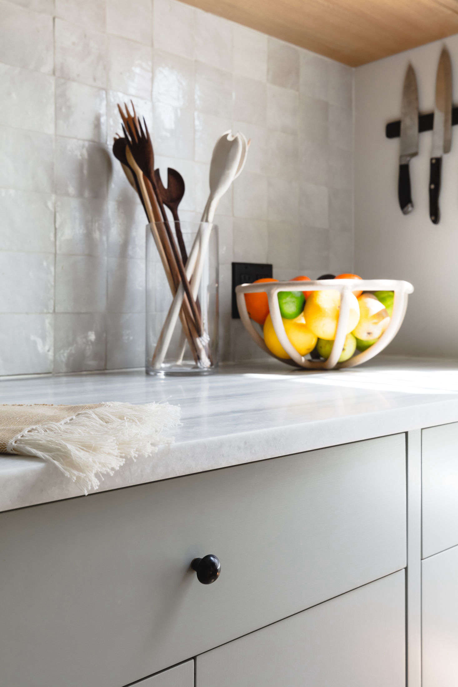 The backsplash is tiled with with Weathered White Zelligefrom Clé that lends the requested human touch: &#8