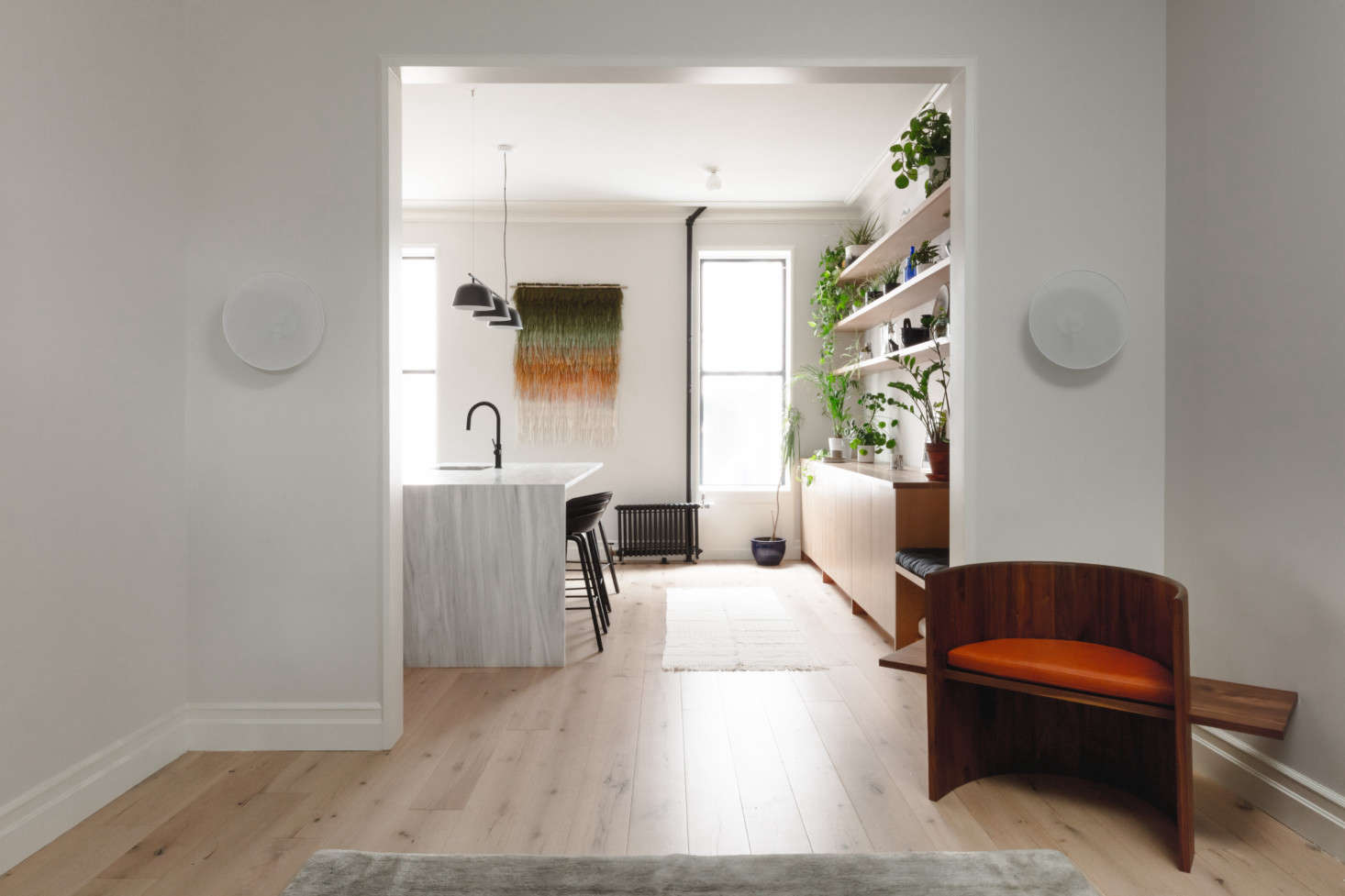 The owners initially wanted the kitchen and living room to be one big loft-like space. &#8