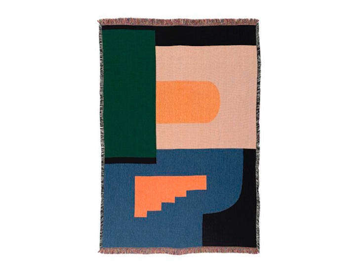 Artist Dee Clements of Chicago-based Studio Herron designs and weaves the cotton throws sold on her website. We&#8