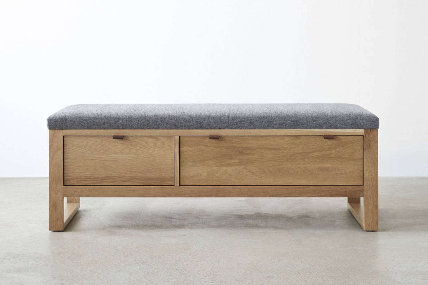 At Unison Home, the Fulton Charcoal Storage Bench is made of solid white oak with an upholstered seat; $src=