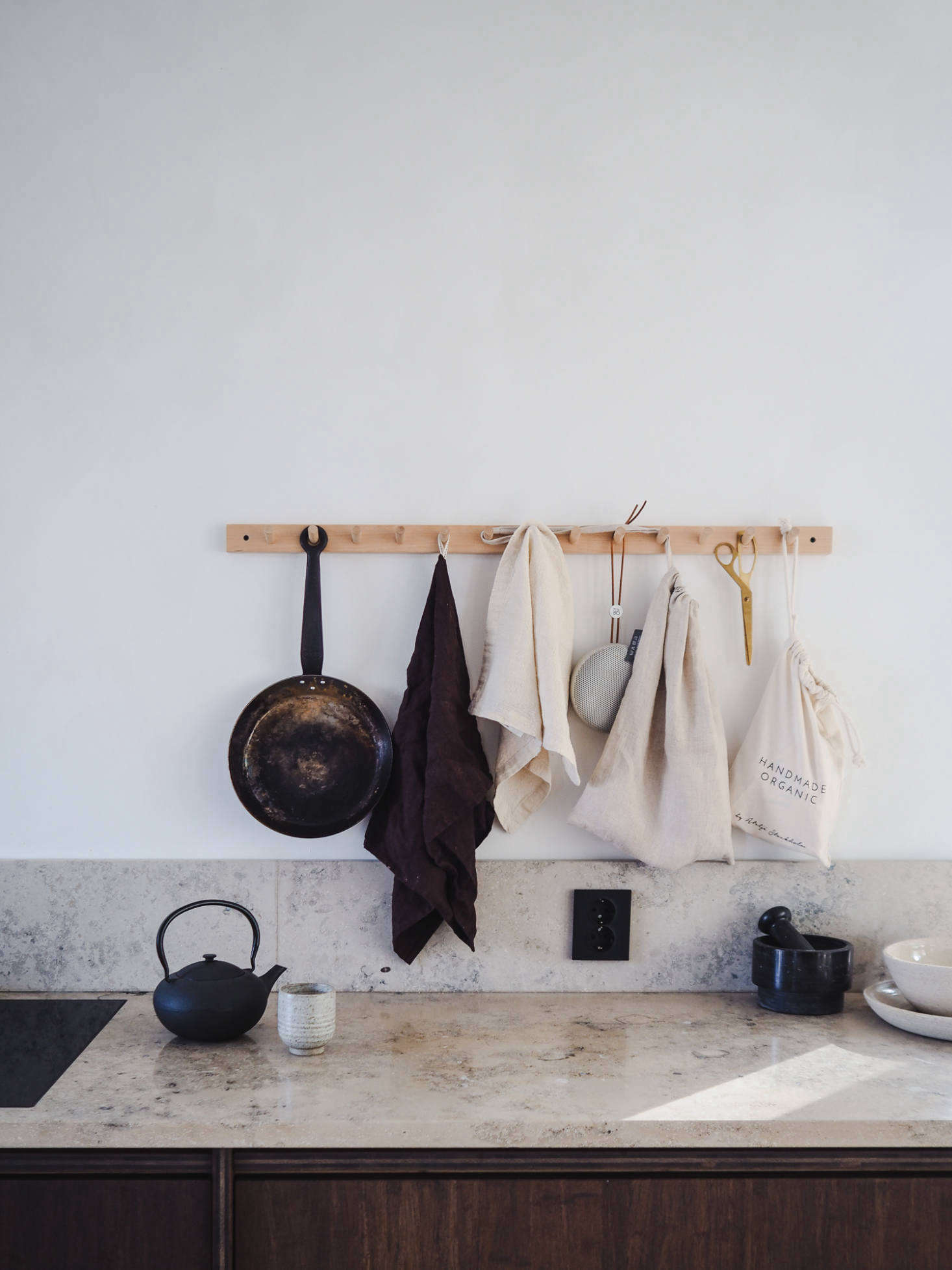 A Birch Hook Rackkeeps crucial kitchen tools off the counter. Discover more of the many uses for peg rails in our book Remodelista: The Organized Home, and for sources see Object Lessons: The Shaker Peg Rail.