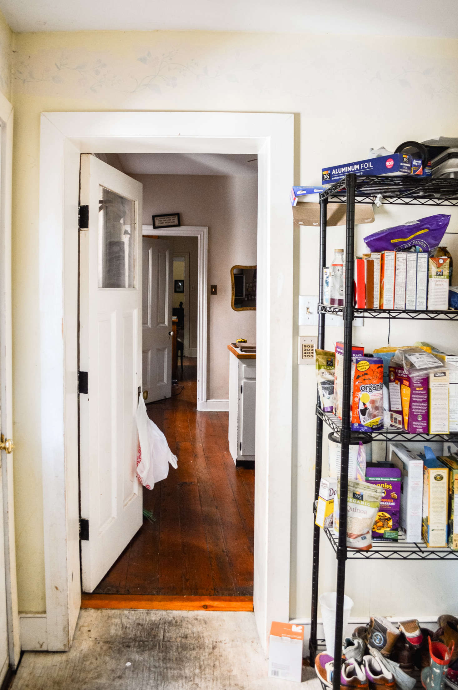 Before the walls came down, the pantry, kitchen, and dining area were small separate rooms.
