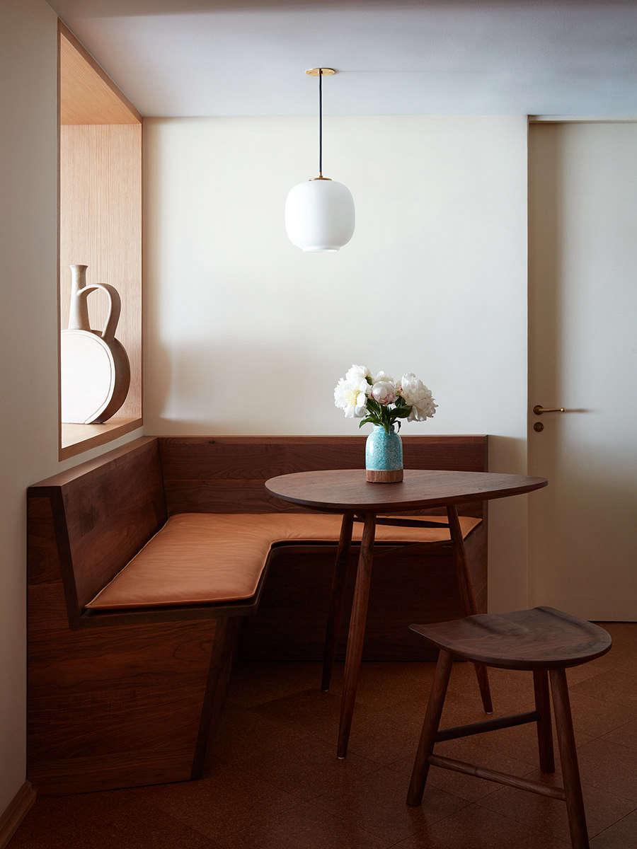 A VL45 Radiohus Pendant hangs in the custom breakfast nook.