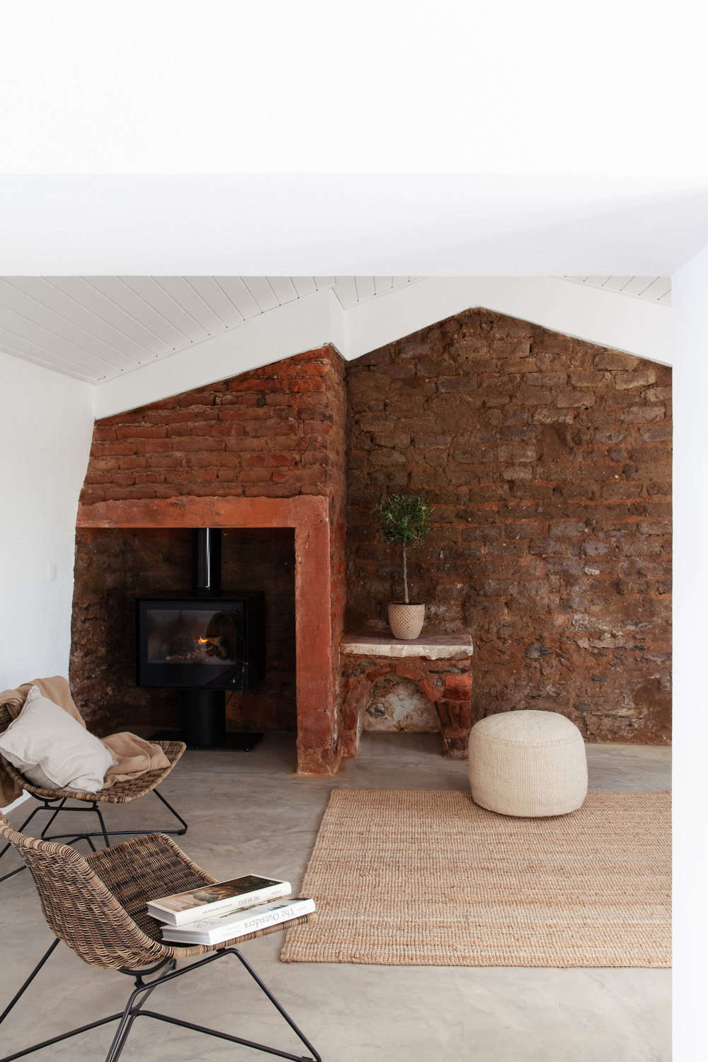 Another lounge area has original exposed-brick walls and a tucked-away wood stove.