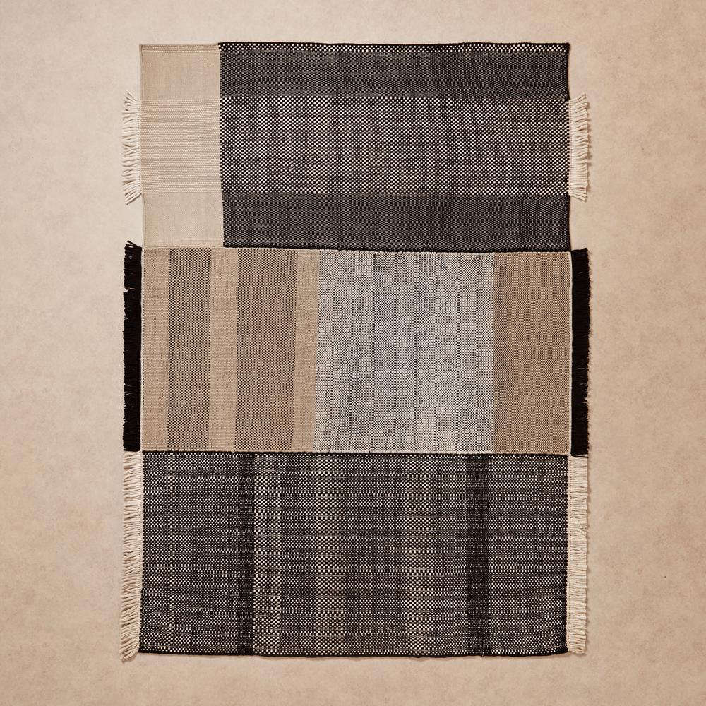 An understated rug with a punk spirit thanks to unconventional tasseling. Nanimarquina&#8