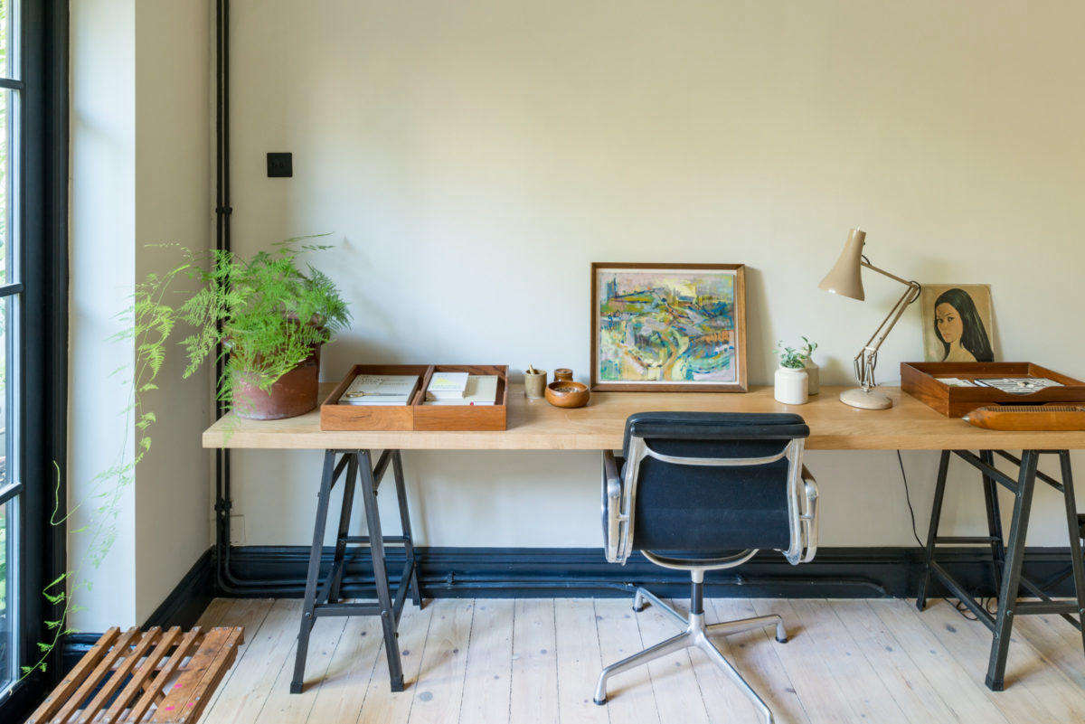 Paul commissioned the oak desk to fit the space.