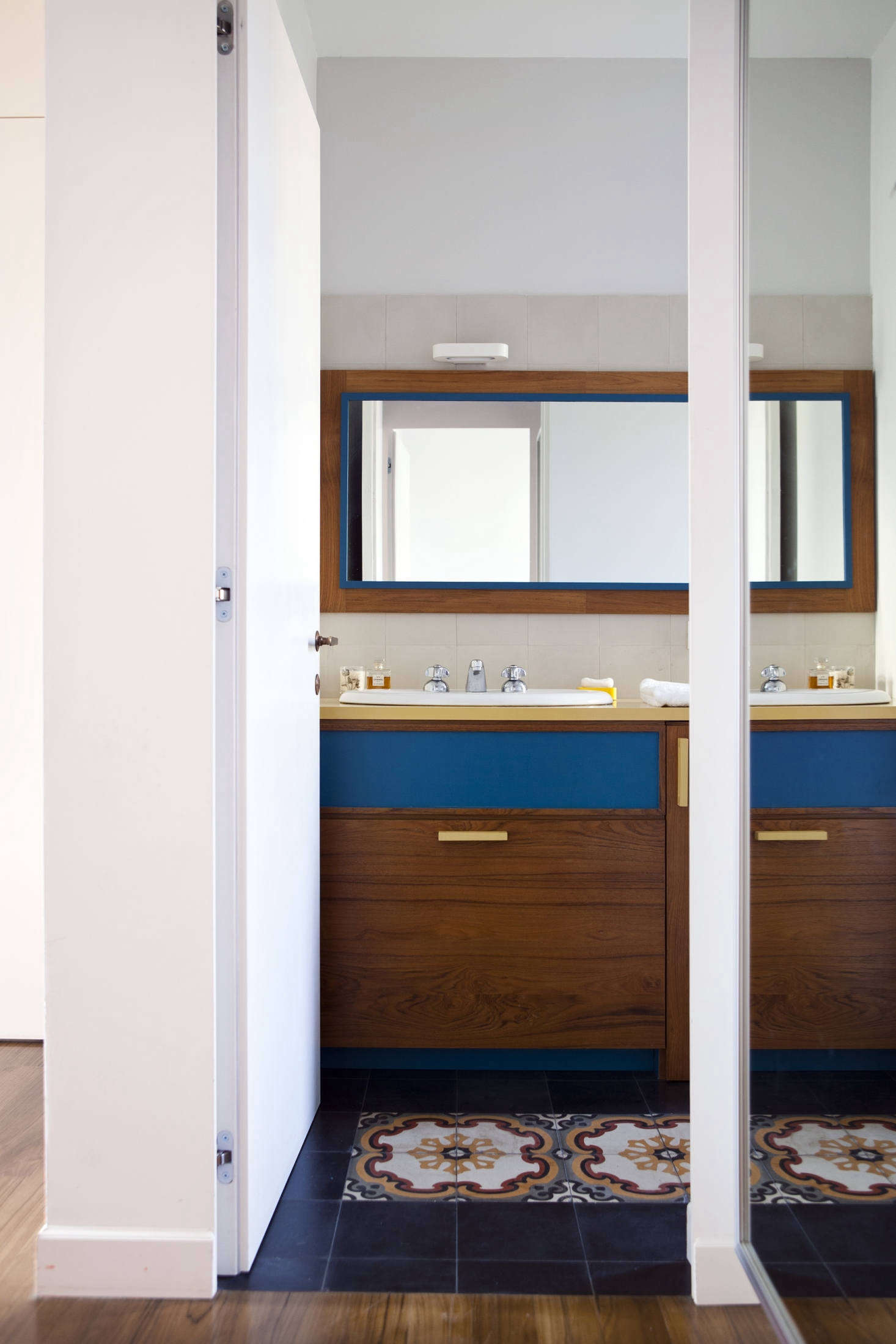 One of two bathrooms. Hand-glazed tiles appear throughout the house like stepping stones: &#8