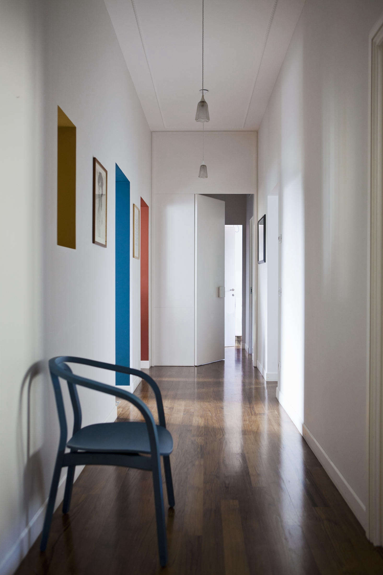The architects used paint in an unusual way throughout, like painting the insides of doorways in Tuscan Red and Gauze Dark, both by Little Greene. Looking down the hall, the doorways almost look like canvases hung on the walls.