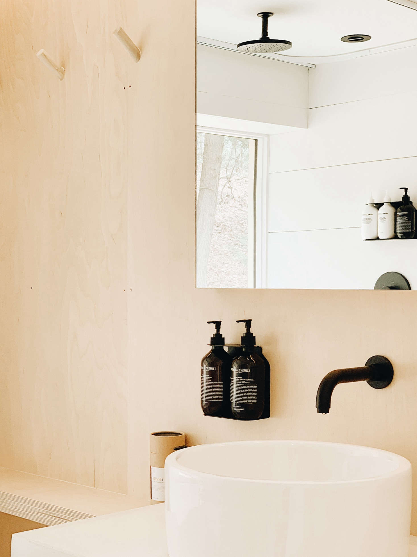 The house is stocked with Hand Soap and other toiletries by Grown Alchemist, neatly hung on black metal Soap Dispenser Holders from DesignStuff of Australia. (Amazon offers the similar Ceremony Home  Wall-Mount Soap Dispenser with Glass Bottle.)