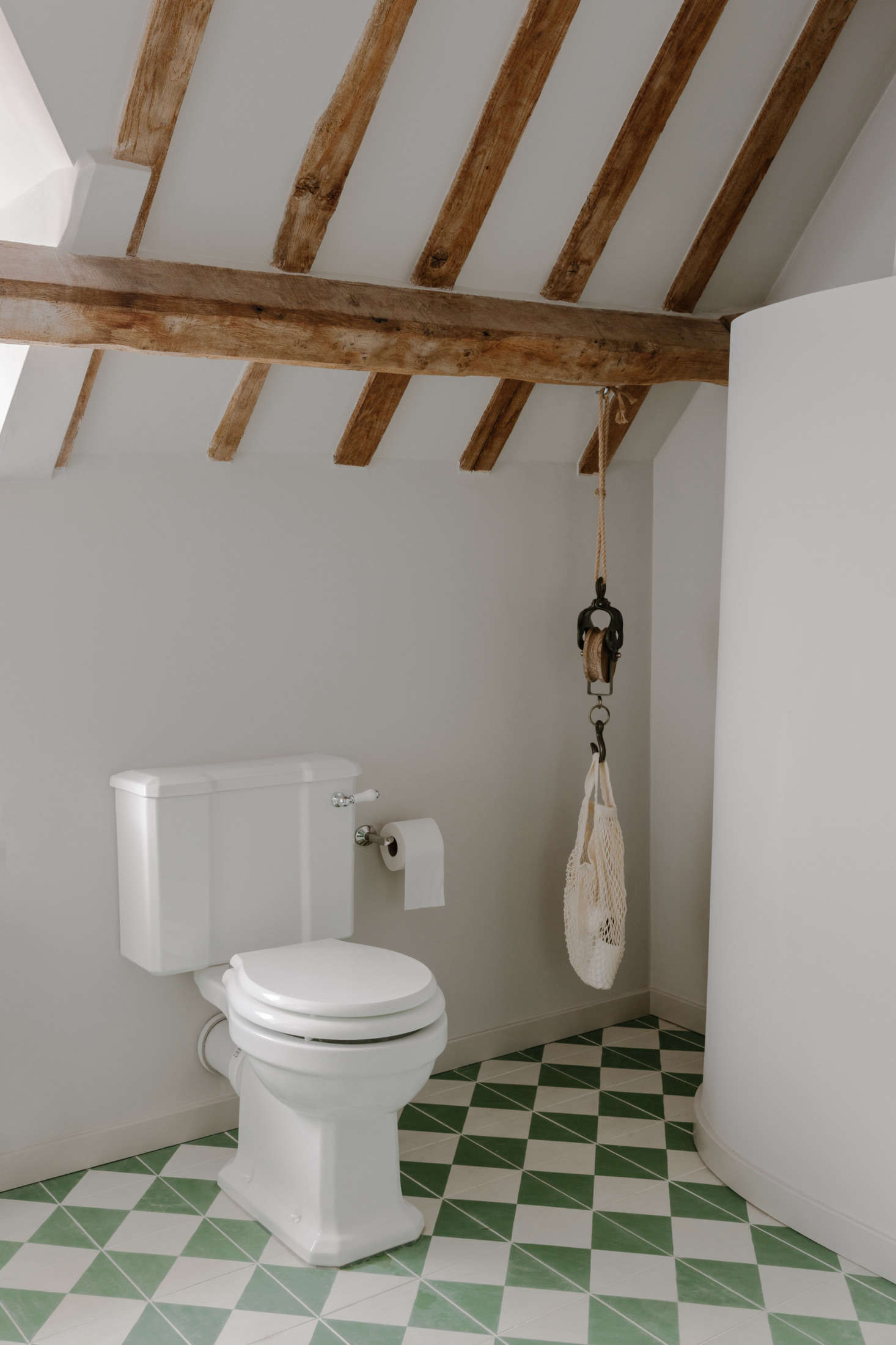 In the WC is a smart way of corralling spare toilet tissue. &#8