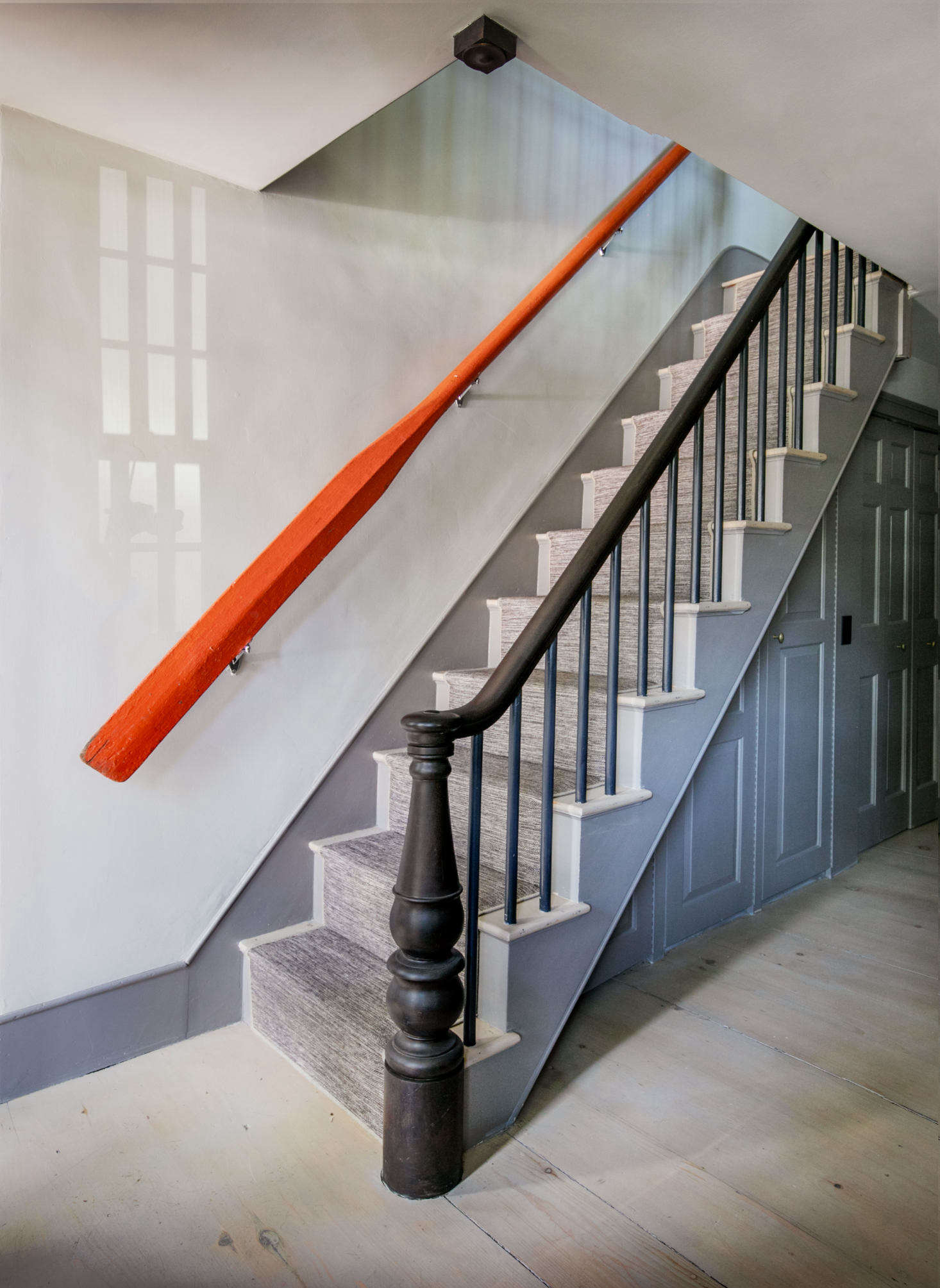 Philip and Kristin mounted an oar as handrail, adding a dash of color to the entryway.