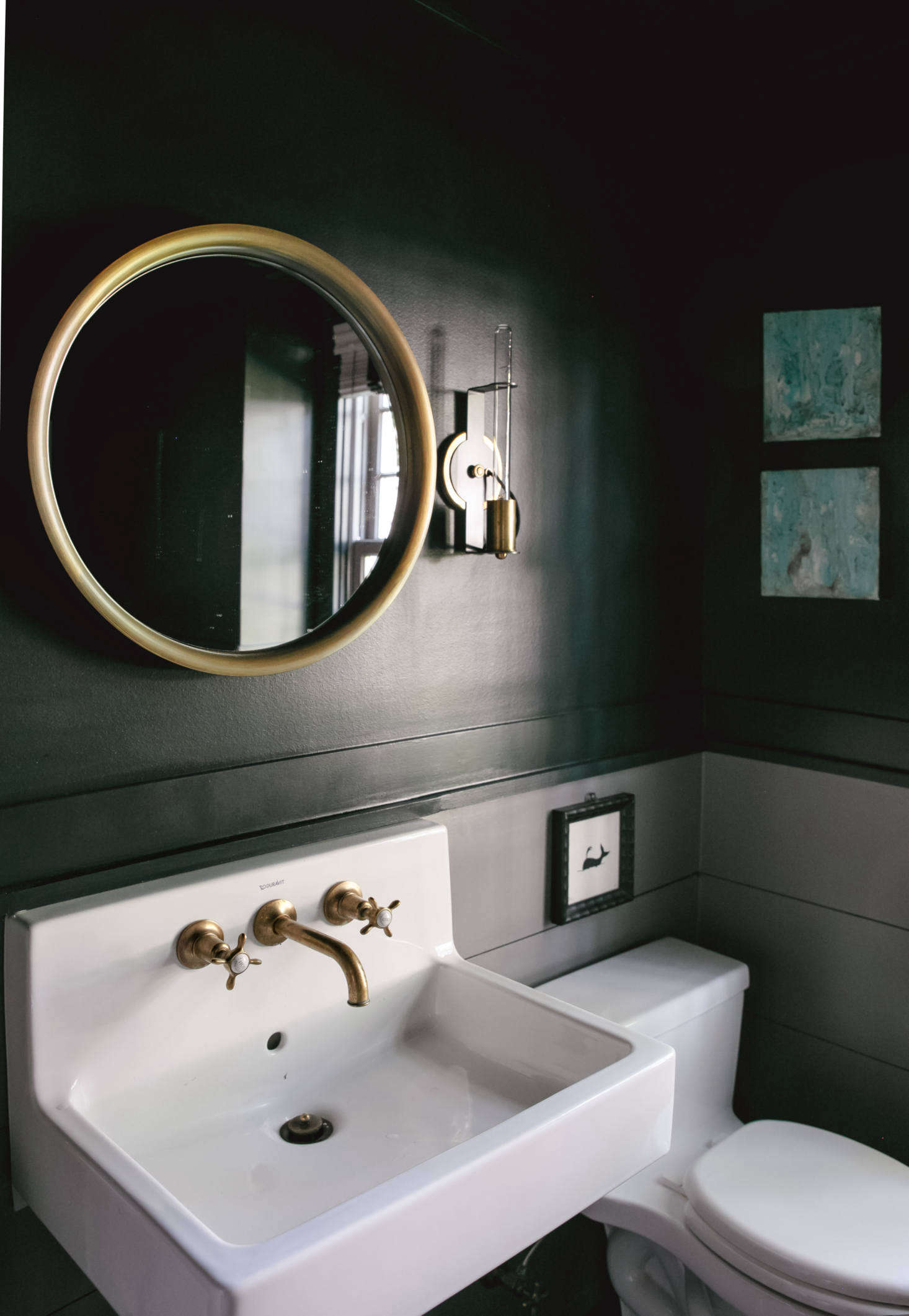 The wall-mounted Vero sink is from Duravit and the bath fixtures are Waterworks Highgate in brass.
