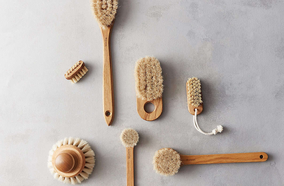 The Oak Handheld Bath Brush by Iris Hantverk (center) is $ at Terrain.