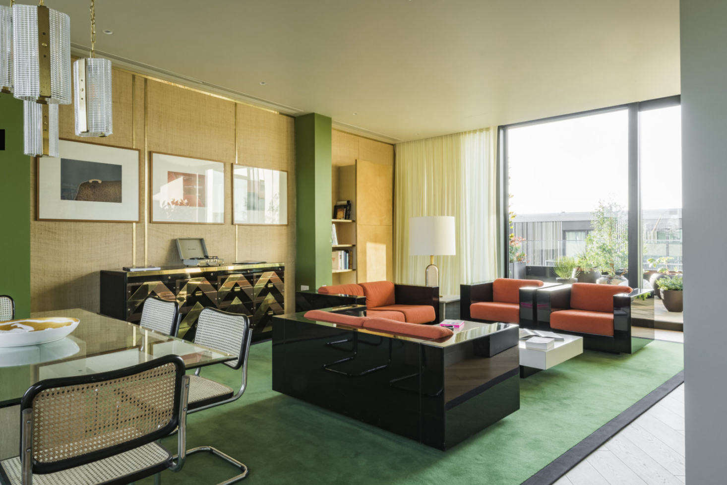 The collection of vintage furnishings was sourced by Maria Speake, co-founder of Retrouvius. The deep green carpet with black border is a favorite of Freud&#8