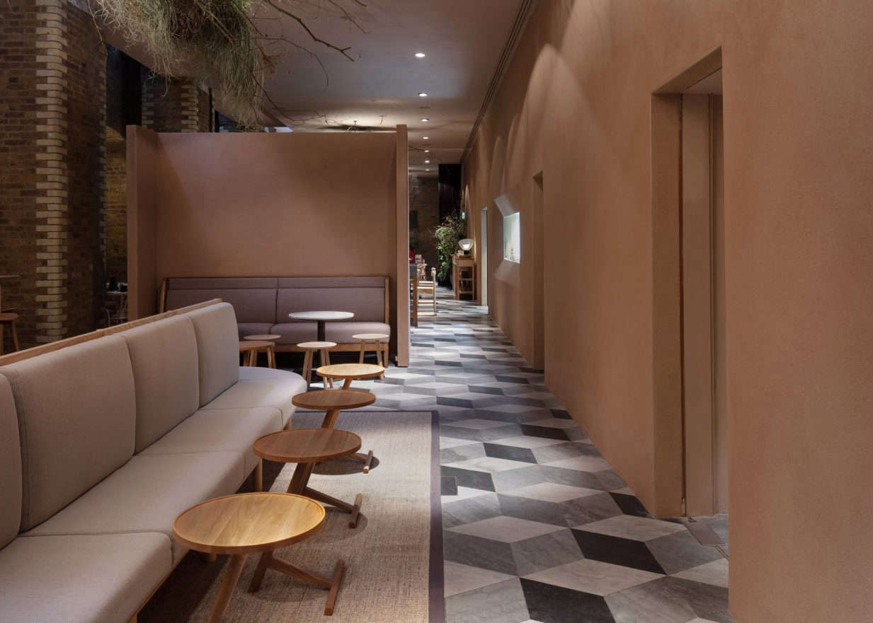 The restaurant is divided into three sections—a bar/lounge area (pictured here), the main dining room, and a private dining area. The original tiled marble floors, laid out in an arresting graphic pattern, remain; while it&#8