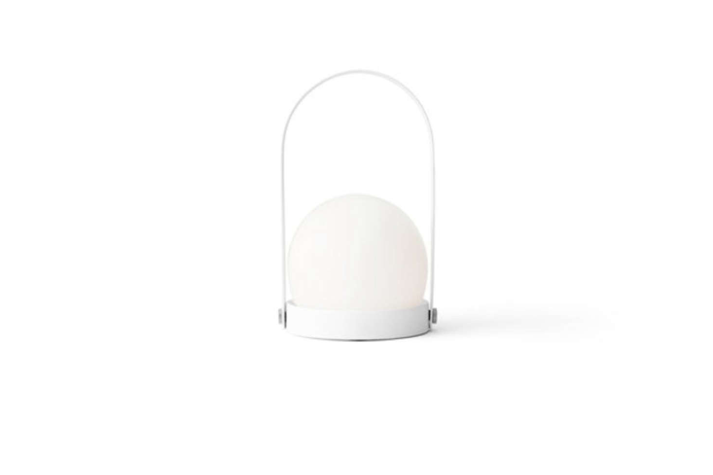 The Carrie LED Table Lamp in White designed by Norm Architects for Menu is portable, working both indoors and outdoors, and made of powder-coated steel and opal glass; $9.95 to $9.95 at Y Lighting.