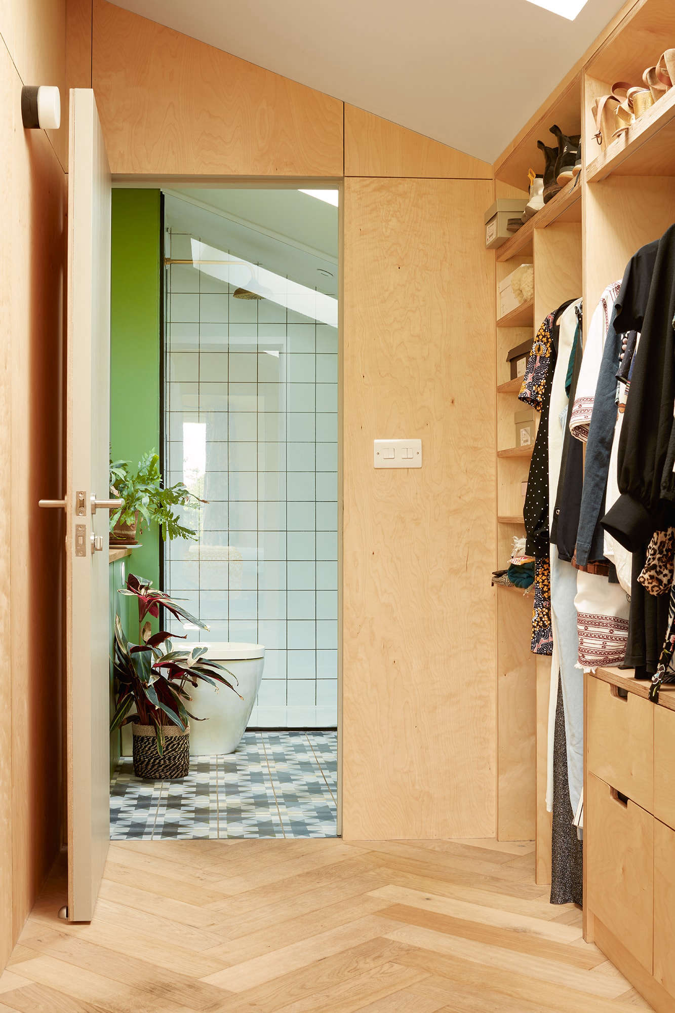 The walk-through plywood closet in the master bedroom.