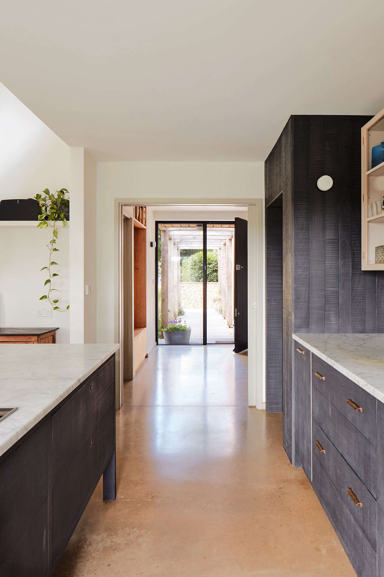 The view toward the front door. The cabinets are by deVOL. The concrete flooring on the first level is original to the home.