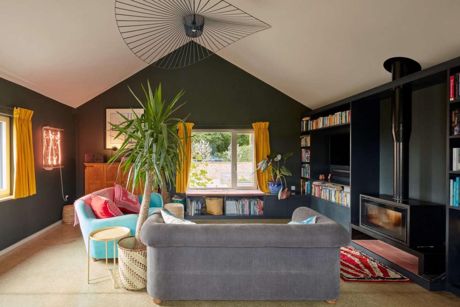 The Vertigo Pendant Light by Constance Guisset hangs over the cozy living room.