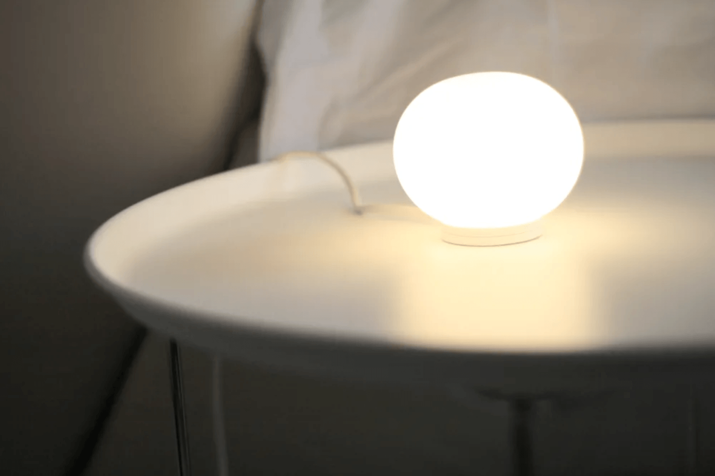 The FLOS Glo-Ball Mini T Table Lamp is a classic opal diffused glow lamp designed by Jasper Morrison. It&#8