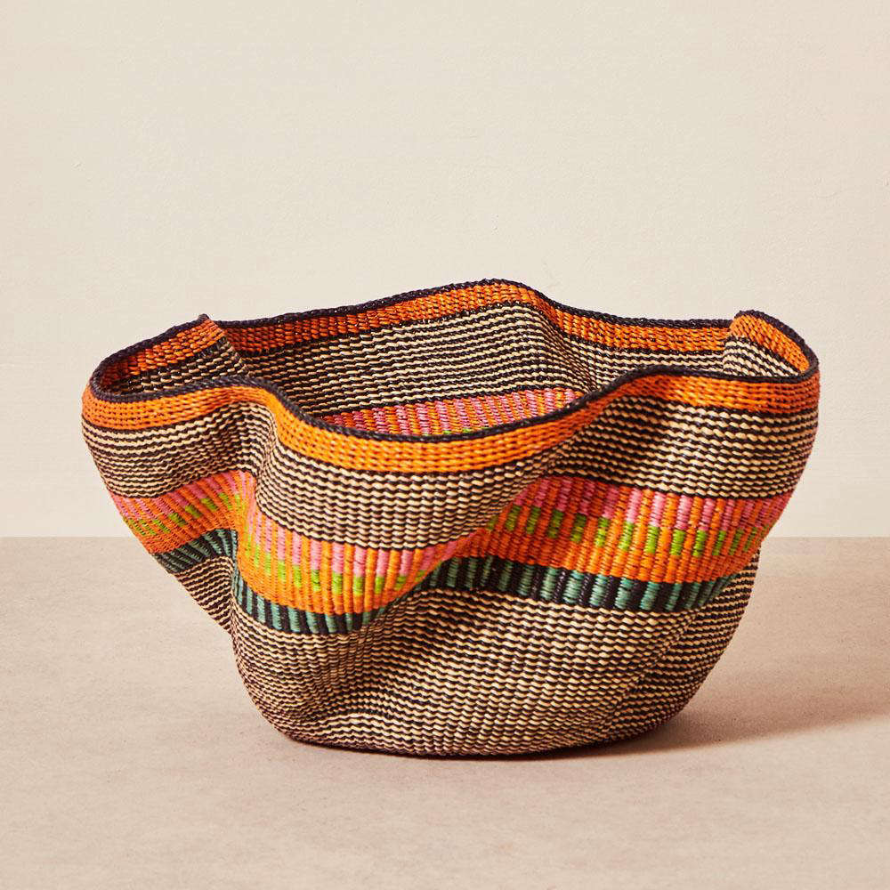 Another favorite from the collection: one-of-a-kind handwoven Pakurigo Baskets, made of vetiver grass by Baba Tree&#8