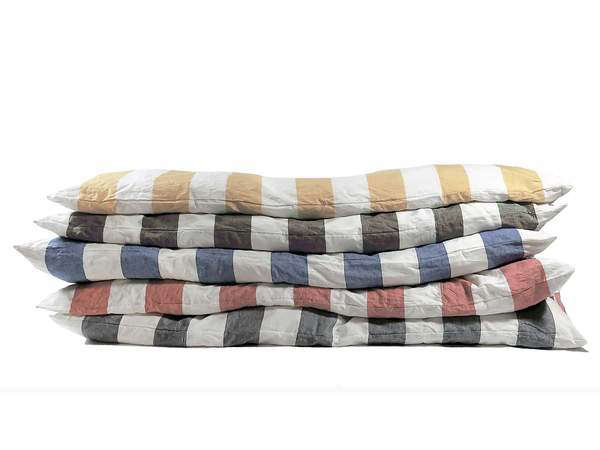 LA-based Hedgehouse makes a large selection of Throwbeds in classic preppy patterns (think stripes, gingham, stars, and plaids); from $375.