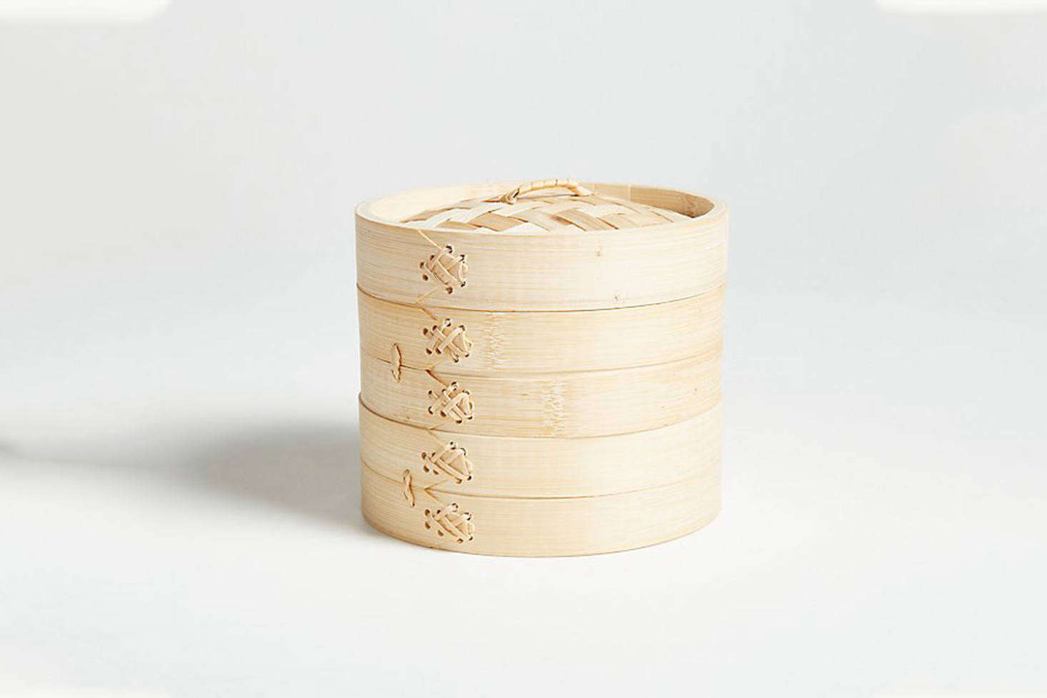 The Joyce Chen 6-Inch Bamboo Steamer is a classic stacked bamboo steamer set that sits on top of a standard 6-inch pot; $.99 at Crate & Barrel.