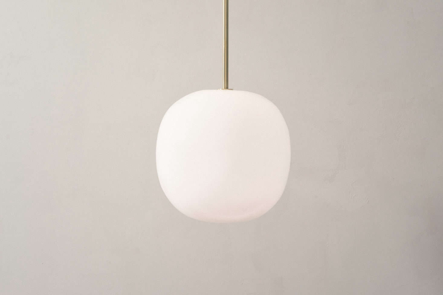 The glass and brass Boulder Pendant mimics the organic form of its namesake; $975.