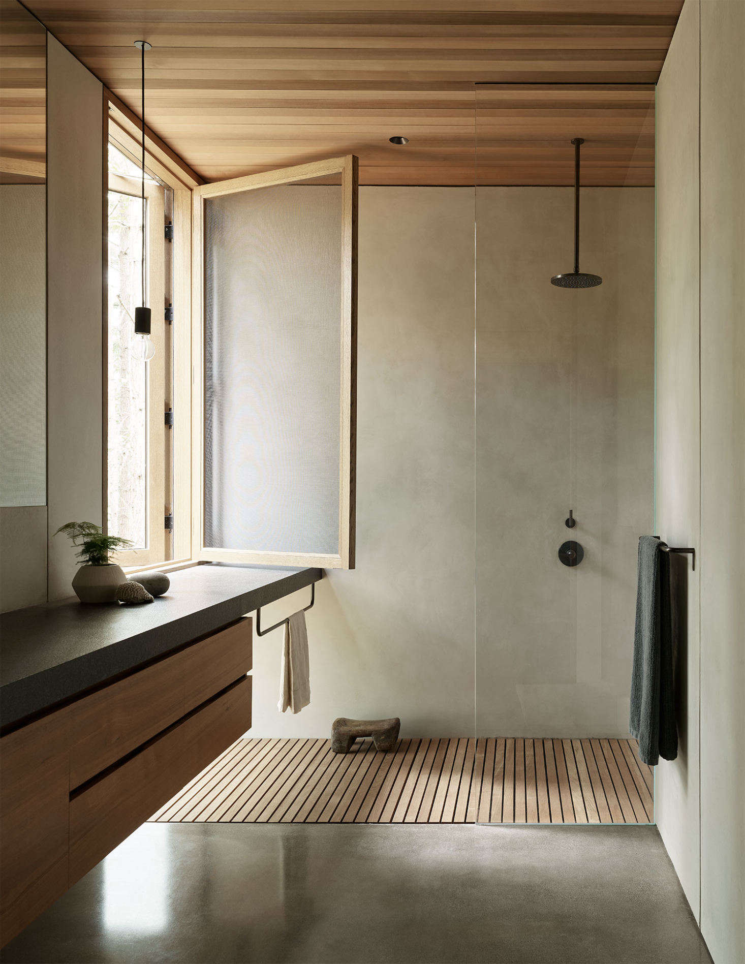 Zen perfection in the bathroom, which features a shower with a view. &#8