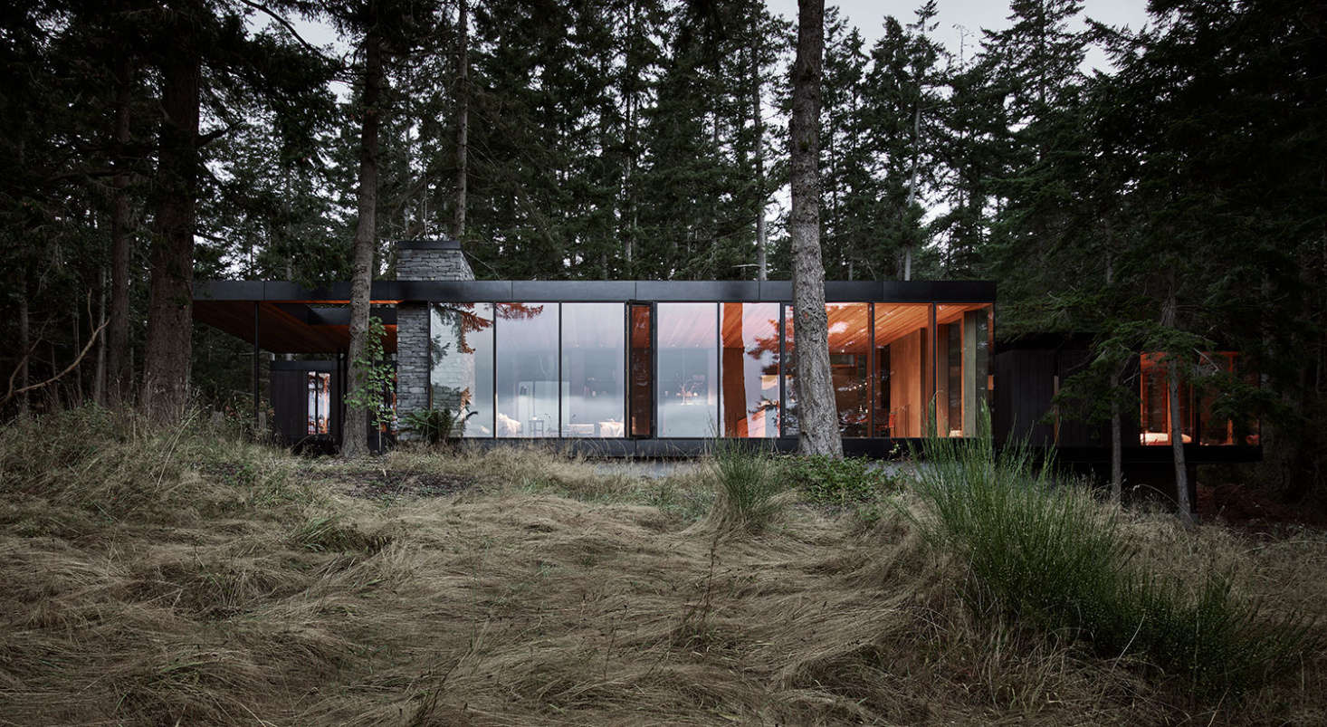 The structure was designed to recede into the forest. At the owners&#8