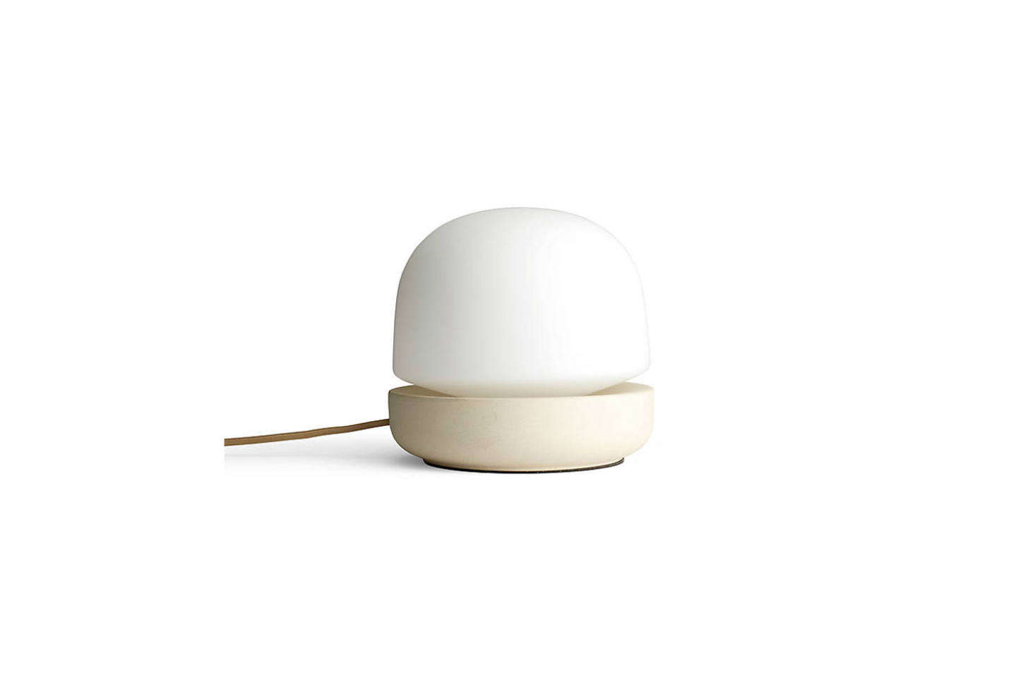 Designed by Norm Architects for Menu, the Stone Table Lamp is made with cream-colored glass and a porcelain base; $3.95 at Lumens.