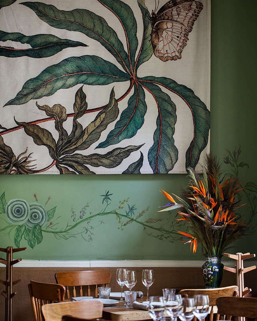 The third floor dining room has oversized canvases depicting floral closeups.