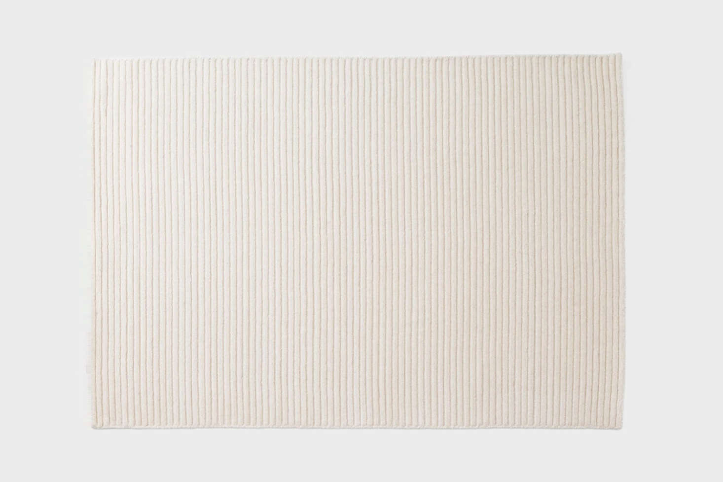 From Schoolhouse, the Ribbed Wool Rug in ivory is a hearty, textured rug made from 0-percent wool; $999 for the 9&#8