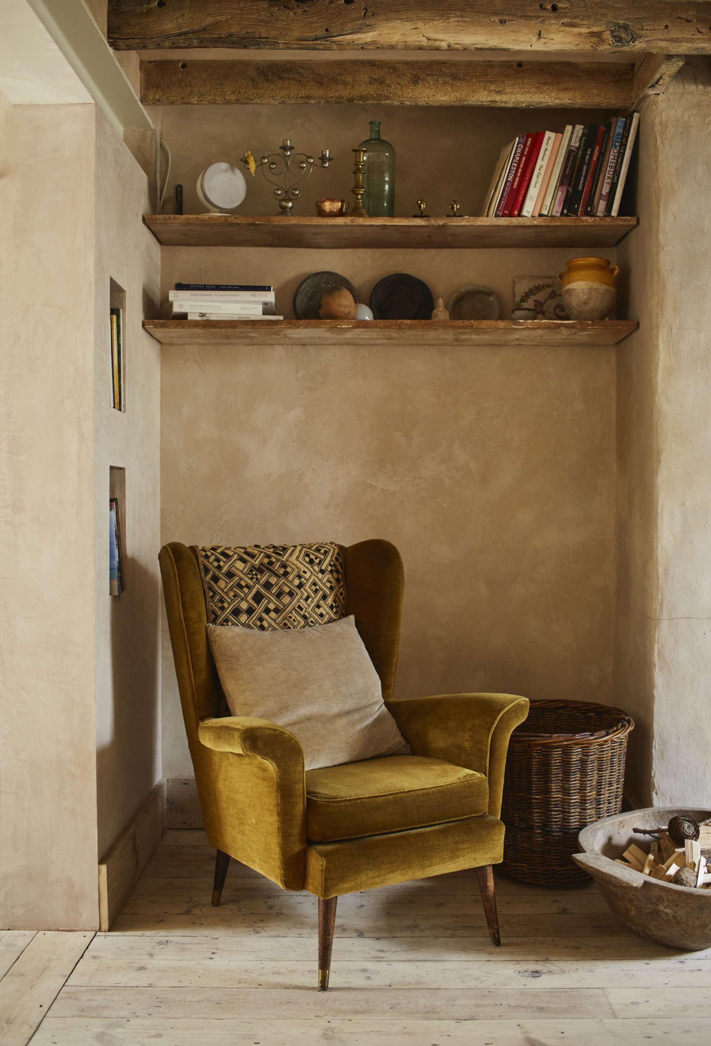 The house is located near Portobello Road—the costume designer bought her velvet-upholstered armchair on Goldborne Road, at the far end of the Portobello Market.
