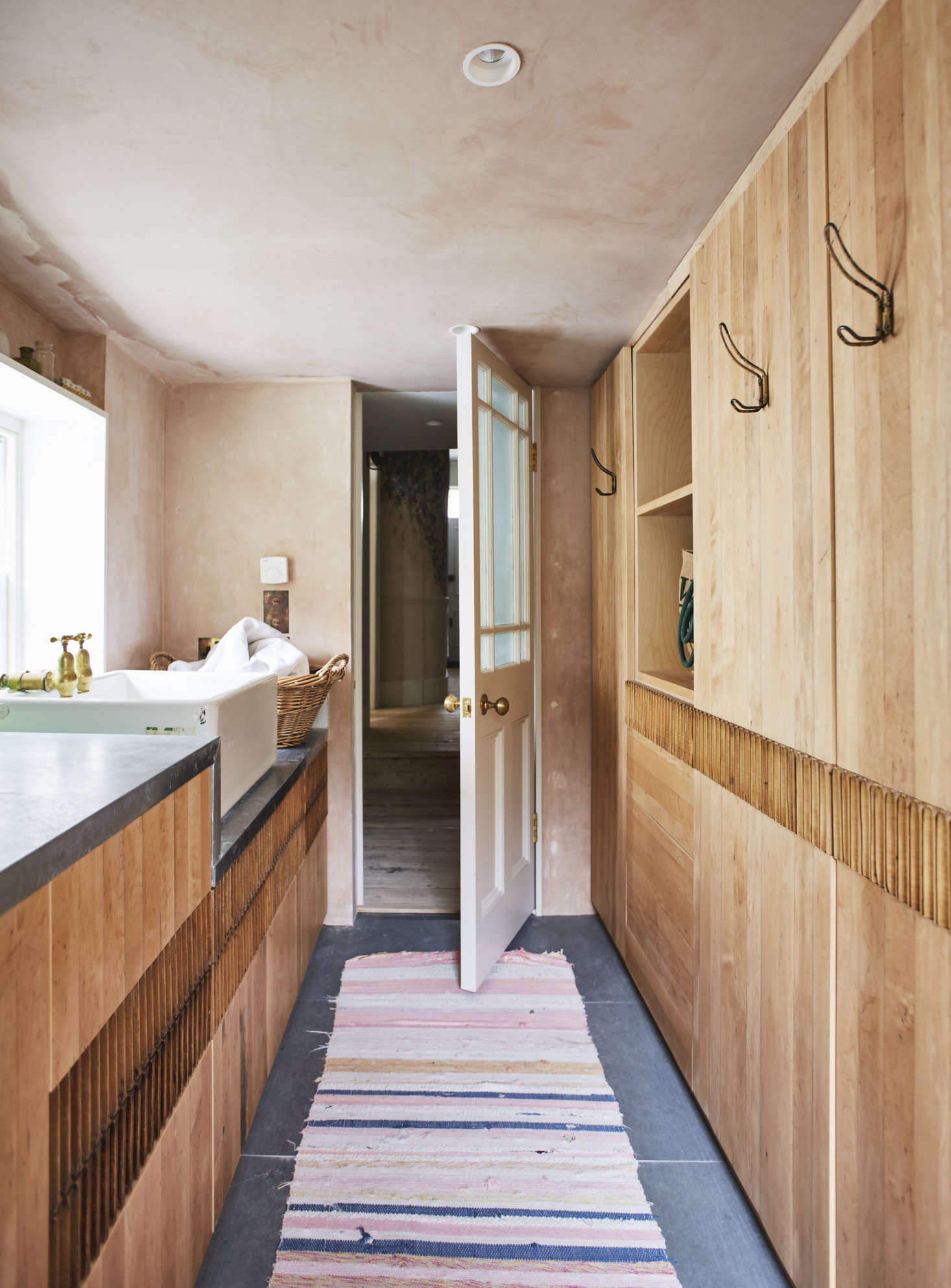 The laundry, with it cupboards of reclaimed maple, is a &#8