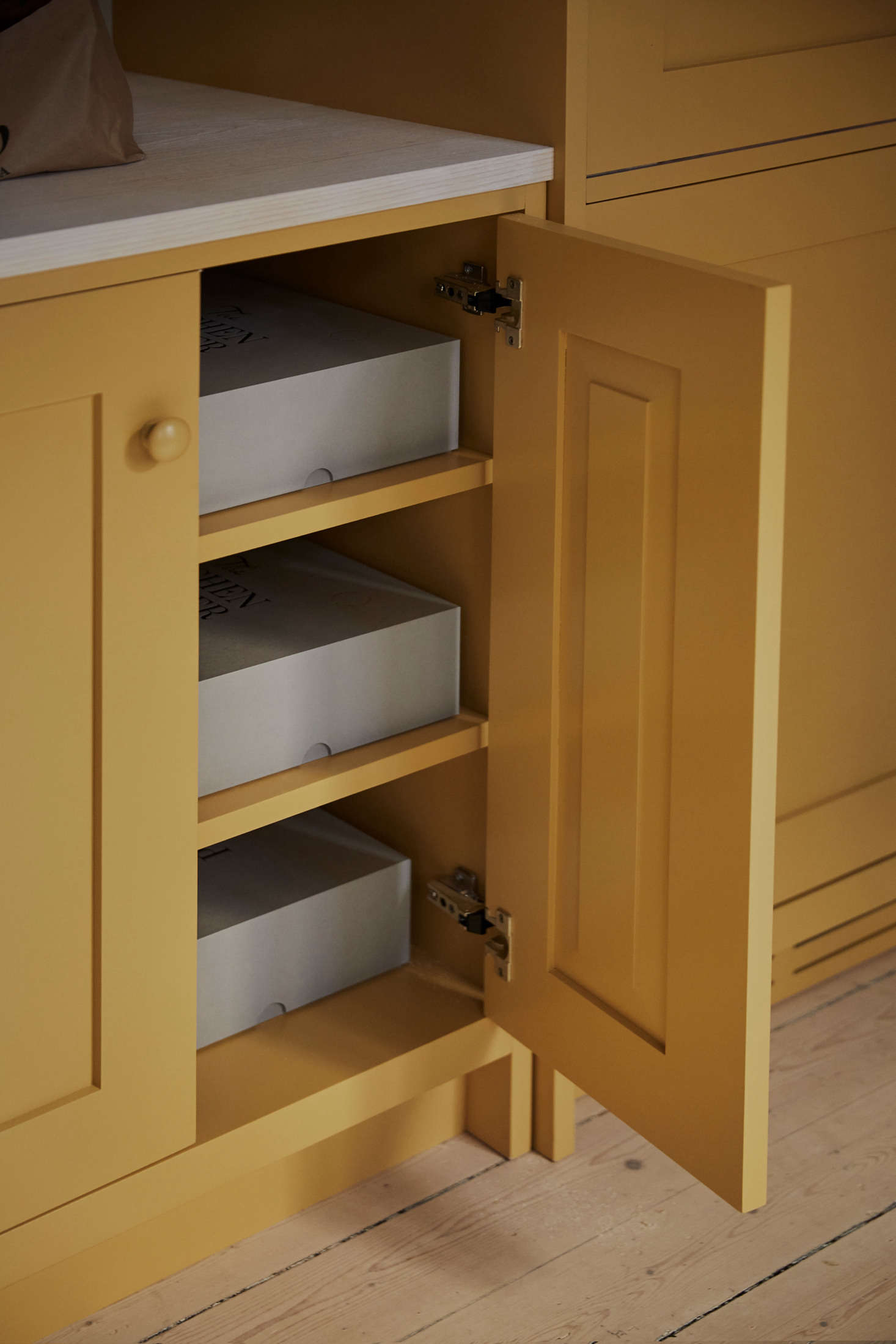 The cabinets and drawers are made of solid oak with dovetail joinery and drawn butt hinges.