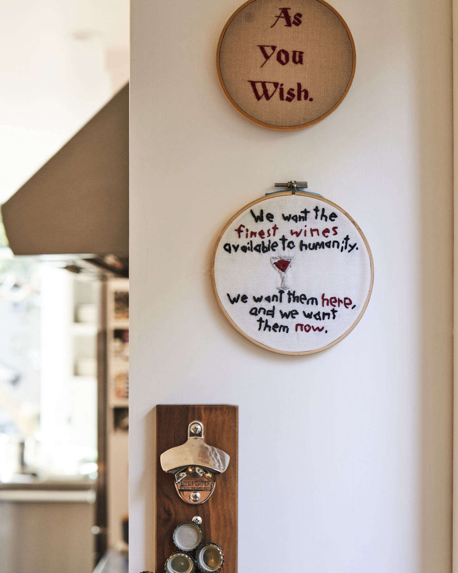 Two needlepoint pieces, bearing famous quotes from a couple of Matt&#8
