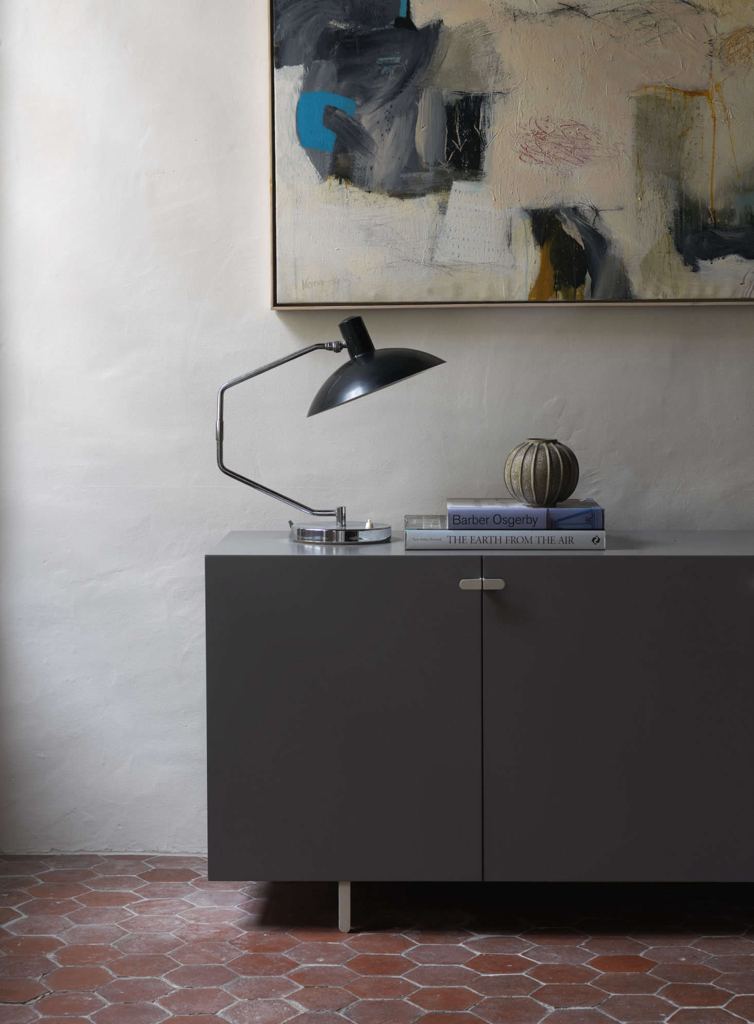 A lamp from Knoll by Clay Mitcie sits on a cabinet from Isokon Plus.