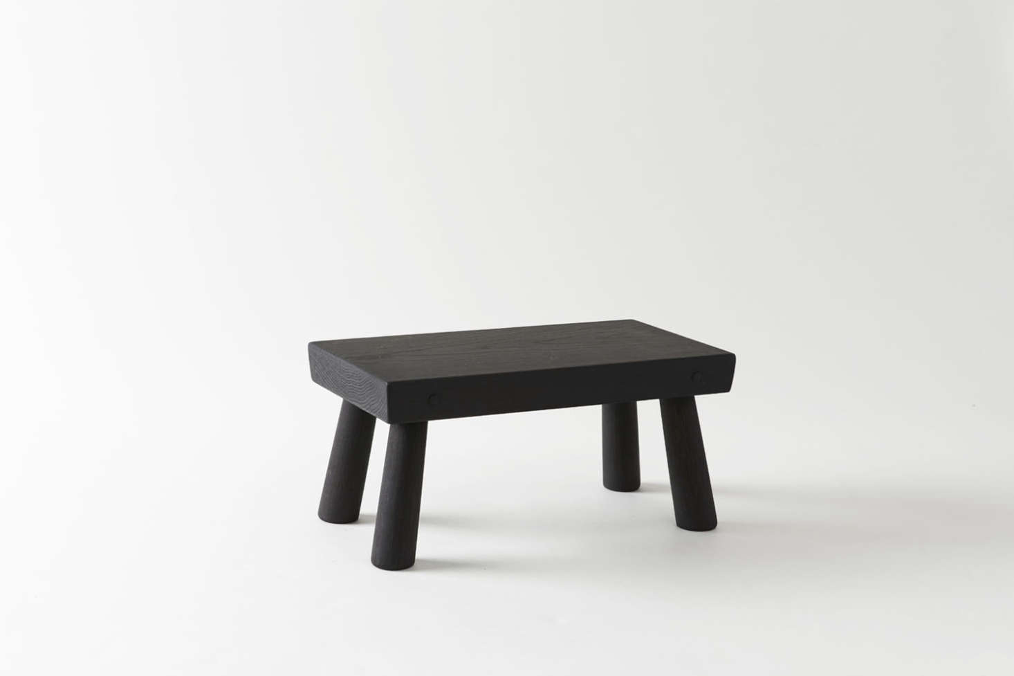 Available through MARCH, the Blackcreek Mercantile & Trading Co. Step Stool is a short step up (7.5 inches) and is available in six different finishes of white oak for $460. For more than one kid, the Blackcreek Mercantile & Trading Co. Long Step Stool is over twice the length; $785.