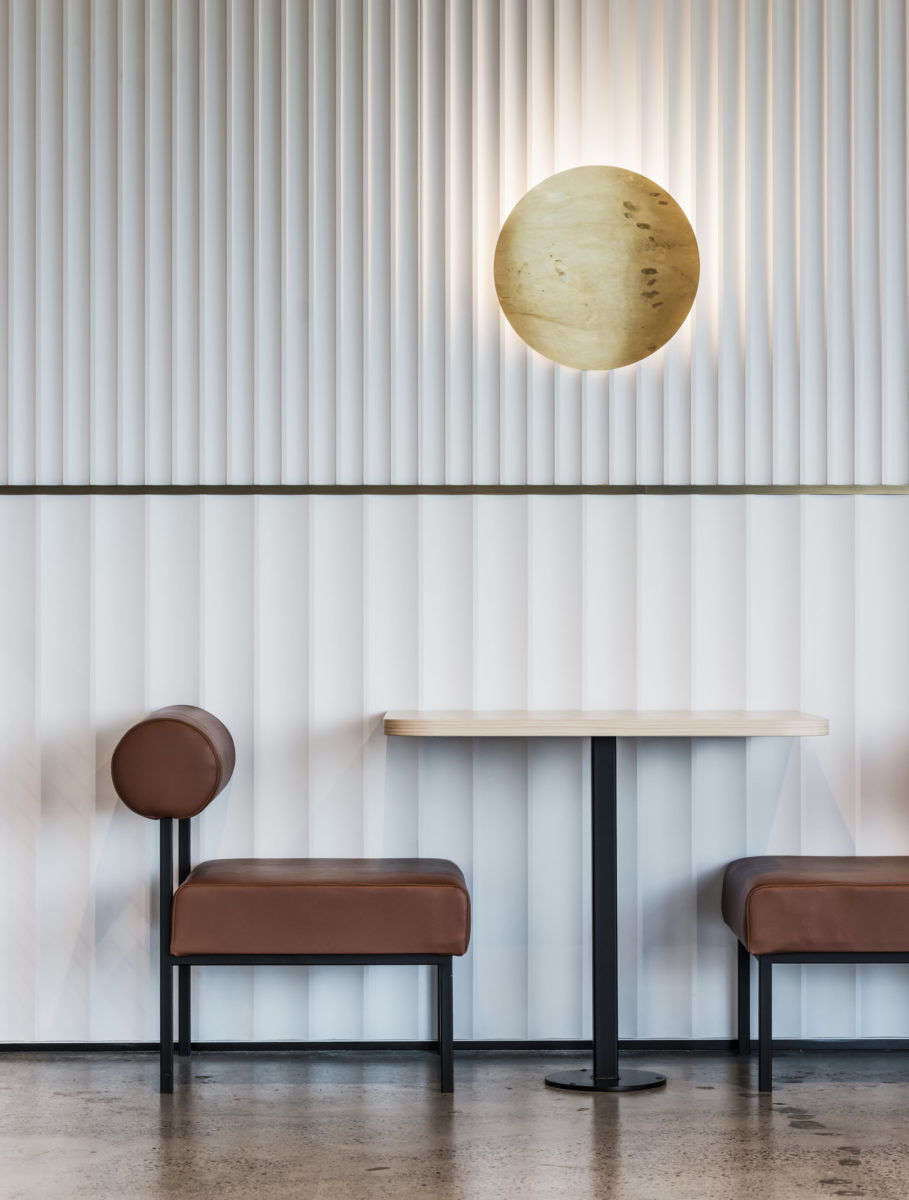 Wide and narrow fluting runs up the walls of the in-house café at tech company NCR&#8
