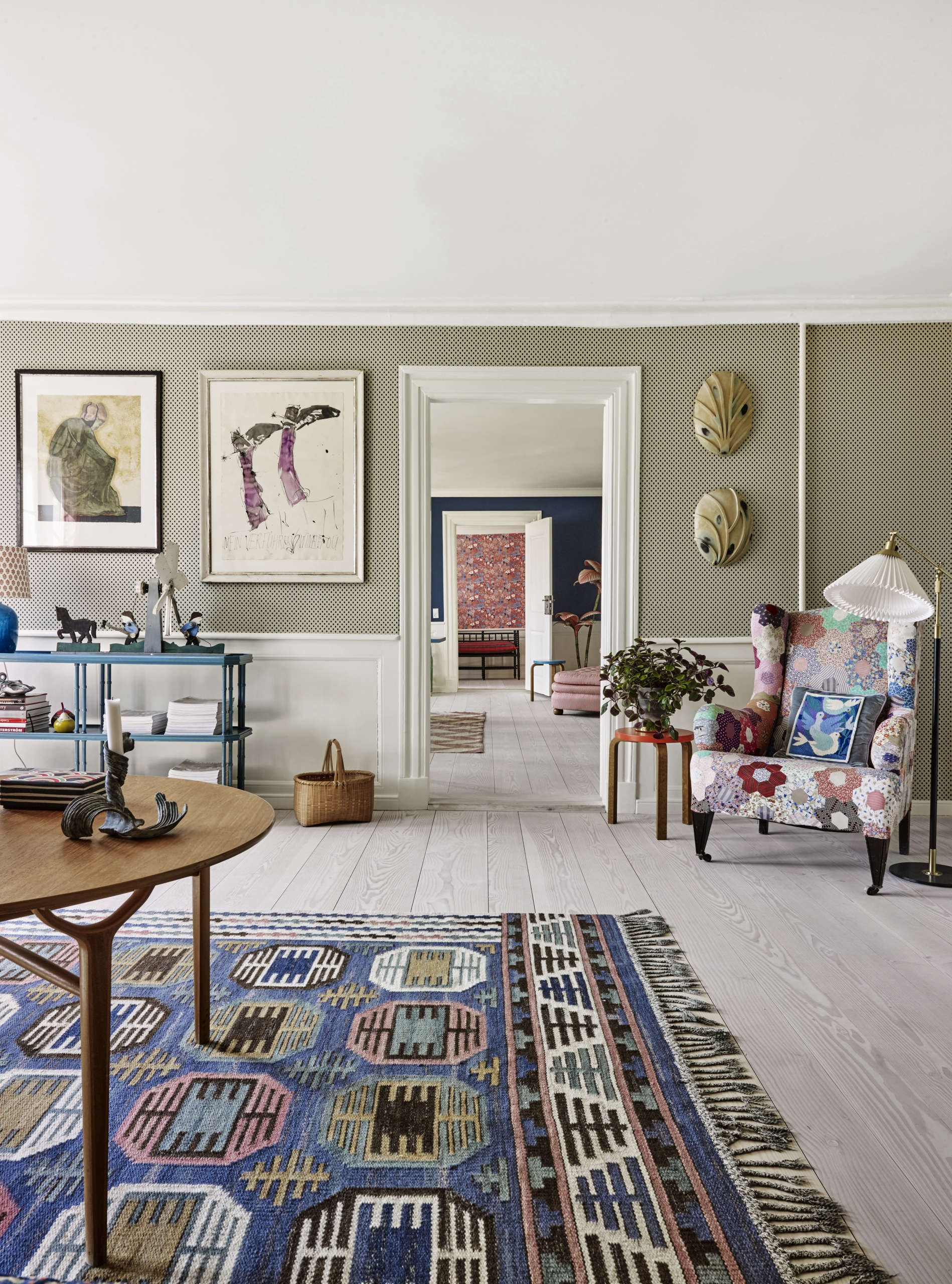 In the living room, a wing chair is upholstered in a classic American hexagonal quilt pattern. (Tina also hangs quilts as art; see her collection of antique quilts here.) The Flat Weave Rug is a 50s Swedish design by Märta Måås-Fjetterström.