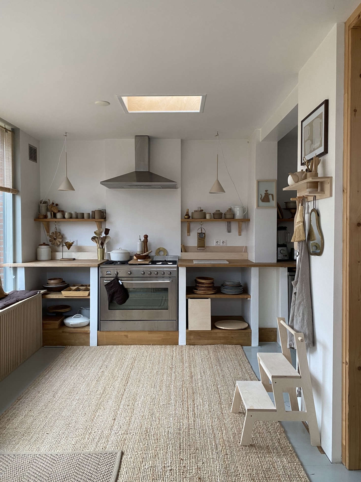 The couple crafted the built-in kitchen shelving and counter themselves. On the right is the Hokata Step Stool and Yori Shelf, both by Woodchuck. Tinta and Rutger like to give their products Japanese names. &#8