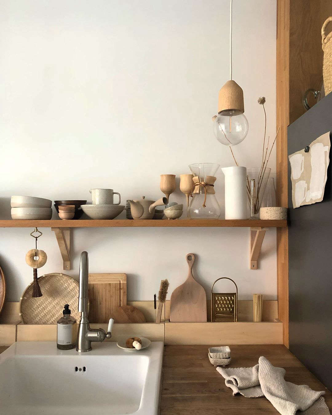 A feature we especially love: the wooden countertop pockets along the wall for storing plates and cooking tools.